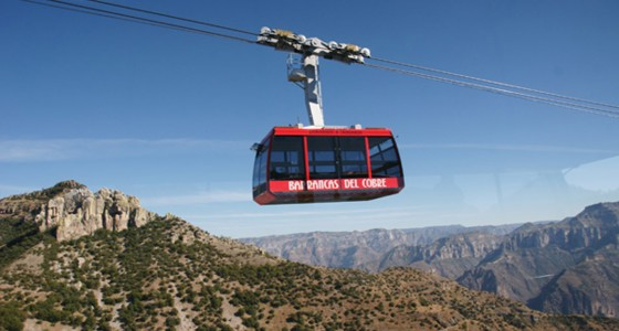 A red cable tram moving over Copper Canyon, Mexico.