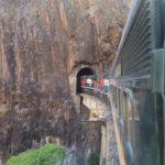 train on rails entering tunnel