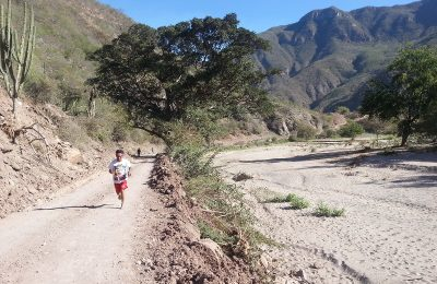 A runner on a dirt road on the Tarahumara river in Mexico.
