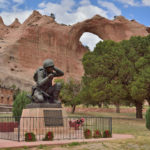 The memorial to the Navajo Code Talkers from WWII, with the Window Rock formation in the background