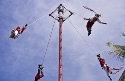 The Danza de los Voladores (Dance of the Flyers), or Palo Volador (pole flying), is an ancient Mesoamerican ceremony/ritual still performed today in Mexico. It is believed to have originated with the Nahua, Huastec and Otomi peoples in central Mexico. The ritual consists of dance and the climbing of a 30-meter pole from which the participants then launch themselves tied with ropes to descend to the ground.
