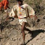 A Tarahumara native running through the canyon